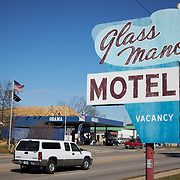 COLUMBIA, SOUTH CAROLINA - JANUARY 27: A sign for the Glass Manor Motel can be seen near an Obama themed gas station off North Main Street in North Columbia, SC on January 27, 2020.   (Photo by Logan CyrusforThe Washington Post)