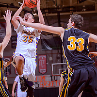 011014       Cable Hoover<br /> <br /> Kirtland Central Bronco Seldon Watson (35) shoots over the St. Pius Sartans Friday at Gallup High School.