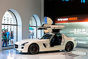 AMG SLS 6.3 Coupe gullwing motor car on display at the AMG Mercedes gallery showroom in Odeonsplatz, Munich, Bavaria, Germany