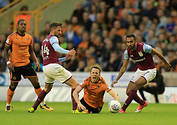 Diogo Jota of Wolverhampton Wanderers is fouled by a combination of Conor Hourihane and Ahmed Elmohamady of Aston Villa - Mandatory by-line: Paul Roberts/JMP - 14/10/2017 - FOOTBALL - Molineux - Wolverhampton, England - Wolverhampton Wanderers v Aston Villa - Skybet Championship