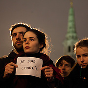 """Many held up signs declaring """" je suis Charlie"""". Londoners show their solidarity with the 12 people killed in an attack on the magazine Charlie Hebdo in Paris and their revulsion of the attack on freedom of speech at a vigil in Trafalgar Square. Three attackers killed ten journalist working for Charlie Hebdo and two police officers, the worst terrorist attack in Paris, France in 50 years."""