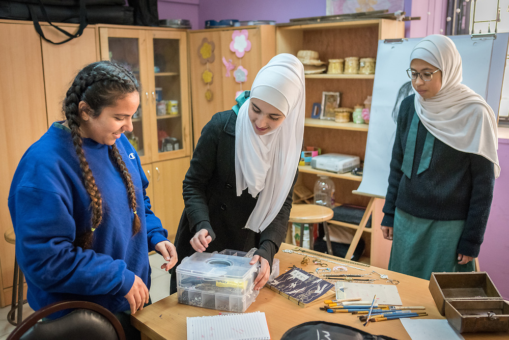 18 February 2020, Amman, Jordan: Fifteen-year-old Rena Almaharmeh (left), 14-year-old Danya (centre) and 15-year-old Asma (right) work in the Talent Room of Rufaida Al Aslamieh Primary Mixed School in the Sahab district. The school serves more than 1,000 students from kindergarten up to 10th grade, most of them girls from Jordan but also some from Syria and other countries, and, in the lower grades, also boys. With support from the Lutheran World Federation, the school has refurbished its rooms and buildings and introduced a 'Talent Room' in order to nurture the children's creativity. This type of learning environment is otherwise rare in Jordanian public shools.