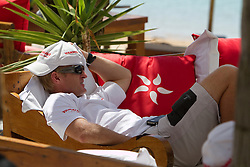 Cameron Dunn of YANMAR Racing relaxing in the hospitality area while crews wait for wind. Portimao Portugal Match Cup 2010. World Match Racing Tour. Portimao, Portugal. 23 June 2010. Photo: Gareth Cooke/Subzero Images