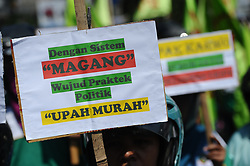 May 1, 2017 - Surabaya, Indonesia - Indonesian workers protest against government regulations and demanding higher wages on May Day on May 1, 2017 in Surabaya, Indonesia. The protests were held against Indonesian President Joko Widodo signing the PP. 78/2015 regulation which states that the main variable for calculation of the minimum wage increase is the national inflation rate and economic growth. Workers consider it extremely detrimental to their interests. (Credit Image: © Robertus Pudyanto via ZUMA Wire)