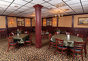 """The main dining area at Cunetto's. Photos at Cunetto's House of Pasta """"On The Hill"""" in south St. Louis taken on Wednesday April 21, 2021 for the Better Business Bureau (St. Louis) Torchlight quarterly magazine. <br />Photo byTim Vizer"""