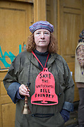Jane Hill protesting against London Borough of Tower Hamlets planning decision to develop the Whitechapel Bell Foundry into a boutique hotel on the 9th November 2019 in East London in the United Kingdom. Whitechapel Bell Foundry closed in June 2017, having cast bells in the East End for almost 450 years. Campaigning with East End Preservation Society, directly petitioning Tower Hamlets Council to preserve the foundry on the grounds of its great historical importance. Operating in Whitechapel from the 1570s — and from its current location since the mid 1740s — the foundry produced world famous bells, including Big Ben, 1858, and the Liberty Bell. Before it shut its doors, Whitechapel was one of two remaining bell foundries in the UK. The site is now owned by property developer, Raycliff, which wants to turn the site into a boutique Hotel.
