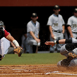 June 05, 2011; Tallahassee, FL, USA; UCF Knights catcher Beau Taylor (13) slides in safe as Alabama Crimson Tide catcher Brock Bennett dives attempting to make the tag during the first inning of the Tallahassee regional of the 2011 NCAA baseball tournament at Dick Howser Stadium. Alabama defeated UCF 12-5. Mandatory Credit: Derick E. Hingle