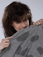 beuatiful caucasian brunette young woman wearing a sweater with hearts on it