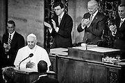 Pope Francis is acknowledged as he arrives in the chamber of the House of Representatives as he continues his six-day U.S. tour speaking to a joint meeting of Congress at the U.S. Capitol in Washington, District of Columbia, U.S., on Thursday, Sept. 24, 2015. The Pope is calling for Americans to do more to fight poverty, curb climate change and help immigrants. His visit runs through Sept. 27, and features stops in Washington, New York and Philadelphia. Photographer: Pete Marovich/Bloomberg