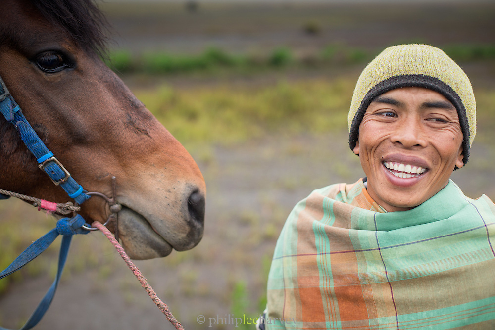 Portrait of man and horse, Mt Bromo, Tengger massif, East Java, Indonesia, Southeast Asia