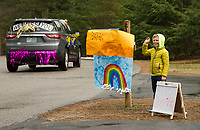 Drew Johnson waves to his teachers as they drive through his neighborhood during the Gilford Teacher Parade on Friday afternoon.  (Karen Bobotas/for the Laconia Daily Sun)
