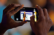 An attendee captures the keynote speech from Facebook's director of small business Jonathan Czaja at Facebook's Boost Your Business Nashville event held at Marathon Music Works on Thursday, Aug. 27, 2015, in Nashville, Tenn. (Photo by Wade Payne/Invision for Facebook/AP Images)