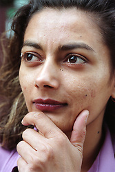 Portrait of young woman looking thoughtful,
