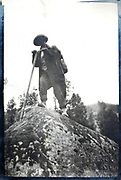 person standing on top of a rock 1930s France