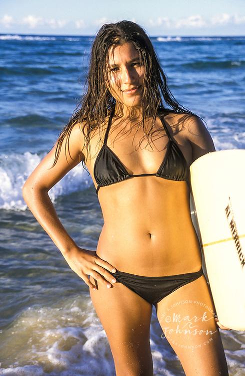 Australia, Queensland, N. Stradbroke Island, female surfer portrait<br /> ****Model Release available