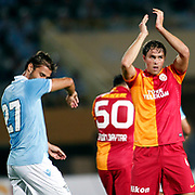 Galatasaray's Johan Elmander (R) celebrating his goal and SS Lazio Lorik Cana (L) during their Friendly soccer match Galatasaray between SS Lazio at the Ataturk stadium in izmir Turkey on Saturday 04 August 2012. Photo by TURKPIX