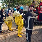 Verdacht poeder aangetroffen ASW Huizen, gaspakken
