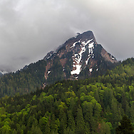 During Spring in the Fraser Valley clouds envelop a ridge on Mount Cheam in Popkum,  British Columbia, Canada