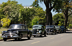 Post WWII-era cars line the historic officer's mansions along Walnut Ave on Mare Island as oscar-winning director Paul Thomas Anderson's  film  'The Master' begins filming.  The movie will star Philip Seymour Hoffman, Joaquin Phoenix, Amy Adams and Laura Dern.