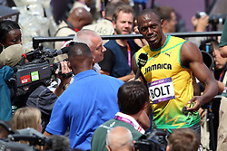 Usain Bolt of Jamaica is interviewed after winning his heat during The Men's 100m heats held on day 2 of athletics held at the Olympic Stadium in Olympic Park in London as part of the London 2012 Olympics on the 3rd August 2012..Photo by Ron Gaunt/SPORTZPICS