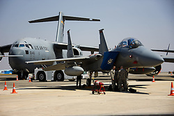 U.S. Air Force's C-17 Globalmaster and F-15 fighter are seen at the Aero India 2015 in Air Force Station Yelahanka of Bangalore, India, Feb. 18, 2015. The biennial air show this year attracted dealers from 49 countries, showcasing their aero-related products in military and civilian fields. EXPA Pictures © 2015, PhotoCredit: EXPA/ Photoshot/ Zheng Huansong<br /> <br /> *****ATTENTION - for AUT, SLO, CRO, SRB, BIH, MAZ only*****