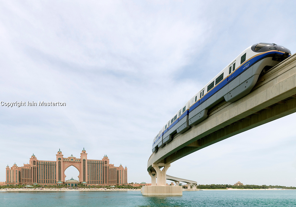 Monorail train approaching The Palm Atlantis luxury hotel on artificial Palm Jumeirah island in Dubai United Arab Emirates