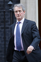 © licensed to London News Pictures. London, UK 21/01/2014. Environment Secretary Owen Paterson attending to a cabinet meeting on Downing Street on Tuesday, 21 January 2014. Photo credit: Tolga Akmen/LNP