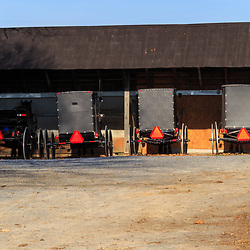 Ephrata, PA / USA - November 26, 2015:  Distinctive black Old Order Amish Mennonite buggies parked in a buggy shed during worship services.