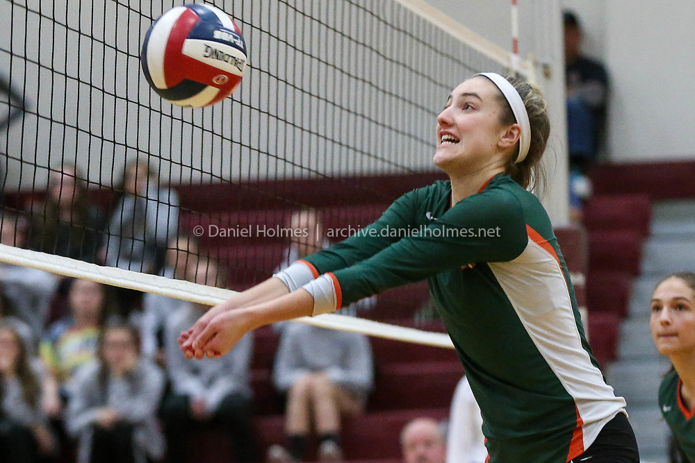 (11/15/17, NORTHBOROUGH, MA) Hopkinton's Ivy Gogolin bumps the ball over the net during the Hillers' Div. 1 girls volleyball state semifinal win over Andover at Algonquin Regional High School in Northborough on Wednesday. [Daily News and Wicked Local Photo/Dan Holmes]