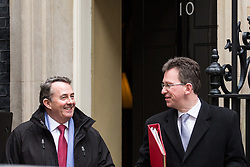 London, UK. 18th December, 2018. Liam Fox MP, Secretary of State for International Trade and President of the Board of Trade, and Jeremy Wright QC MP, Secretary of State for Digital, Culture, Media and Sport, leave 10 Downing Street following the final Cabinet meeting before the Christmas recess. Topics discussed were expected to have included preparations for a 'No Deal' Brexit.