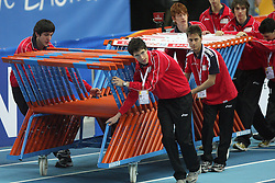 Volunteers bringing hurdles at the 1st day of  European Athletics Indoor Championships Torino 2009 (6th - 8th March), at Oval Lingotto Stadium,  Torino, Italy, on March 6, 2009. (Photo by Vid Ponikvar / Sportida)