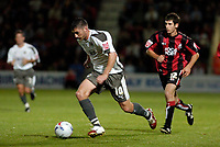 Photo: Leigh Quinnell.<br /> AFC Bournemouth v Bristol City. Coca Cola League 1. 26/09/2006. Bristol Citys Phil Jevons races away from Bournemouths Danny Hollands.