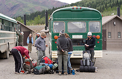 Backpackers get off the park camper bus at the Toklat River rest stop to begin backpacking in Denali National Park and Preserve in Alaska.
