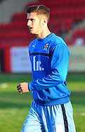 Dominic Ball warms up during the Sky Bet League 2 match between Cheltenham Town and Cambridge United at Whaddon Road, Cheltenham, England on 14 April 2015. Photo by Alan Franklin.