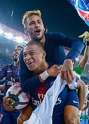 October 7, 2018 - Paris, France - Paris Saint Germain team mates NEYMAR JR, top, and KYLIAN MBAPPE celebrate a 5:0 France Ligue 1 win over Olympique Lyonnais. (Credit Image: © Panoramic via ZUMA Press)