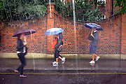 © Licensed to London News Pictures. 25/08/2012. Tourists are caught out in a thunder storm in Notting Hill, London, 25th August 2012 ahead of the Notting Hill Carnival which takes place this weekend.  Photo credit : Stephen Simpson/LNP