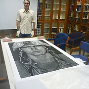 Louie Palu with one of his special one off special large format prints in the collection of the Marine Corps Archives & Special Collections in Quantico, Virginia.<br /> (Credit Image: © Louie Palu/ZUMA Press)