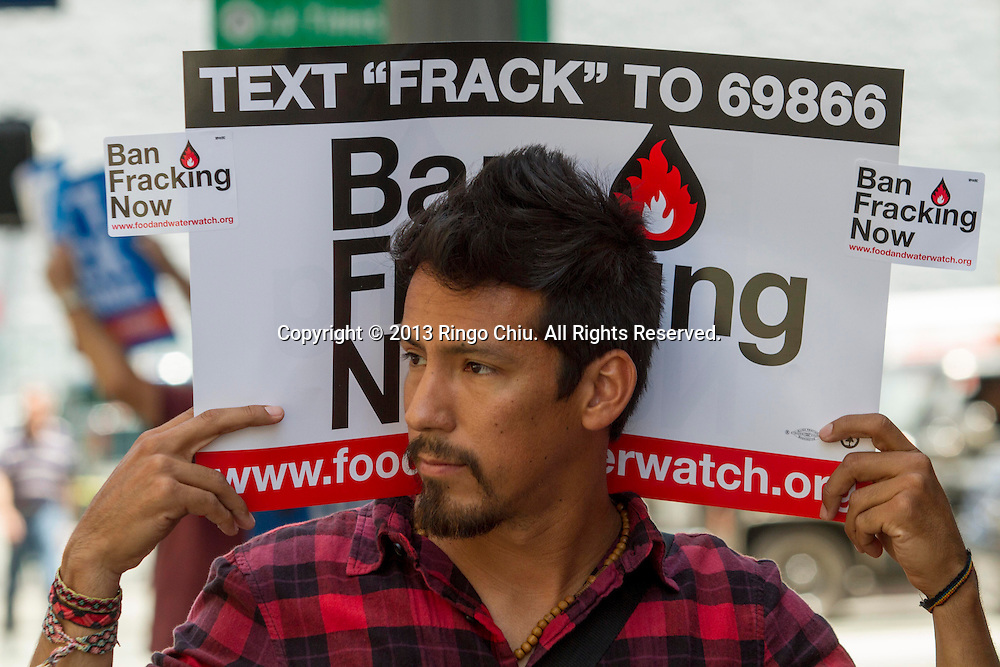 Anti-fracking protestors demonstrate at outside Governor's office Thursday, May 30, 2013, to urging Gov. Jerry Brown to ban fracking in the sate, in Los Angeles, California. More than 100 different organizations gathered for a protest Thursday urging lawmakers to ban oil fracking. Over 200 people showed up at a rally in Los Angeles and 150 people showed up for a protest in San Francisco.  (Photo by Ringo Chiu/PHOTOFORMULA.com)