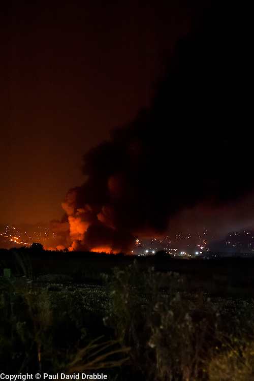 Firefighters are tackling a large blaze at a single storey warehouse on a Sheffield Industrial Estate just off Station Road in Ecclesfield close to South Yorkshire Police Sub Divisional HQ and Chapeltown Academy. The fire started just after 9.30pm this evening and a number of loud explosions have been heard during the course of the night.<br /> <br /> 3 September 2014<br /> <br /> Image © Paul David Drabble <br /> www.pauldaviddrabble.co.uk