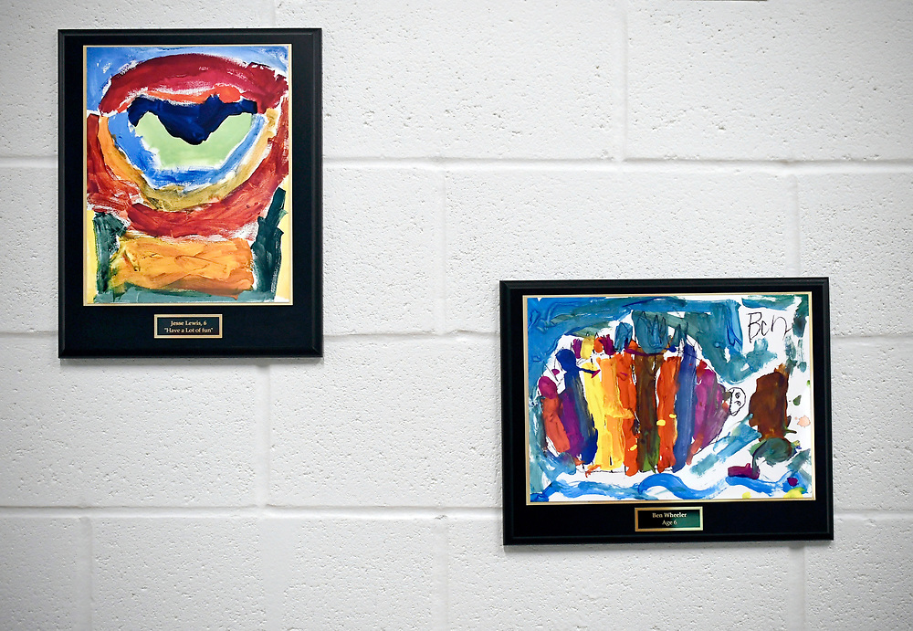 Inside the new Sandy Hook School is framed artwork made by children who were killed in the Sandy Hook School shooting in 2012. Pictures made by six year olds Jesse Lewis, left, and Ben Wheeler, right, seen here in Sandy Hook School, Saturday, Dec. 2, 2017, in Newtown, Conn. (Jessica Hill for the New York Times)