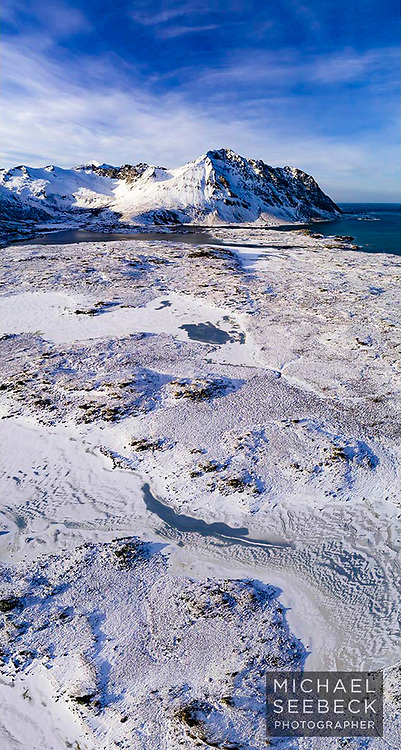 An aerial photograph of an icy wilderness near Lofoten Peninsula, Norway.<br /> <br /> Open Edition print