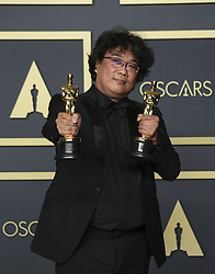 "February 9, 2020, Hollywood, California, USA: Director Bong Joon-ho, winner of the Original Screenplay, International Feature Film, Directing, and Best Picture awards for ""Parasite,"" poses in the press room of the 92nd Academy Awards on Sunday February 9, 2020 at the Dolby Theater in Hollywood, California. BURT HARRIS/BNS/PI (Credit Image: © Prensa Internacional via ZUMA Wire)"
