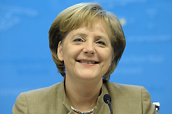 Angela Merkel, Germany's chancellor, smiles during a news conference following the close of the European Summit, Friday, March 20, 2009, in Brussels, Belgium. (Photo © Jock Fistick)