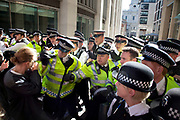 "Police lines blocking Paternoster Square clash with demonstrators. Occupy London protest, October 15th 2011. Protest spreads from the US with this demonstrations in London and other cities worldwide. The 'Occupy' movement is spreading via social media. After four weeks of focus on the Wall Street protest, the campaign against the global banking industry started in the UK this weekend, with the biggest event aiming to ""occupy"" the London Stock Exchange. The protests have been organised on social media pages that between them have picked up more than 15,000 followers. Campaigners gathered outside  at midday before marching the short distance to Paternoster Square, home of the Stock Exchange and other banks.It is one of a series of events planned around the UK as part of a global day of action, with 800-plus protests promised so far worldwide.Paternoster Square is a private development, giving police more powers to not allow protesters or activists inside."