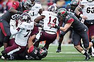 LITTLE ROCK, ARKANSAS - NOVEMBER 23:  Damian Williams #14 of the Mississippi State Bulldogs is tackled by Jarrett Lake #39 and Brooks Ellis #51 of the Arkansas Razorbacks at War Memorial Stadium on November 23, 2013 in Little Rock, Arkansas.  The Bulldogs defeated the Razorbacks 24-17.  (Photo by Wesley Hitt/Getty Images) *** Local Caption *** Damian Williams; Jarrett Lake; Brooks Ellis