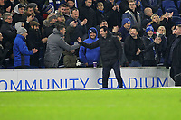 Football - 2018 / 2019 Premier League - Brighton and Hove Albion vs. Arsenal<br /> <br /> Arsenal Head Coach Unai Emery apologises after the final whistle to some Brighton fans after kicking a water bottle into the crowd during the Premier League match at The Amex Stadium Brighton  <br /> <br /> COLORSPORT/SHAUN BOGGUST