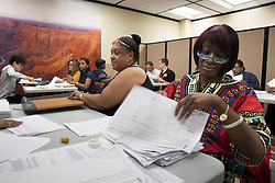 July 5, 2018 - Phoenix, Arizona, U.S - Workers in the Arizona Secretary of State office begin the process of checking petitions to get an initiative that would require the state to adopt a goal of using 50% renewable energy by 2030 on the November ballot. More then 400,000 signatures were submitted for the measure on the last day to submit petitions for various issues in the state. (Credit Image: ©  via ZUMA Wire)