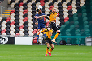 Newport County's Ryan Taylor (29) battles for possession with Mansfield Town's James Perch (14) during the EFL Sky Bet League 2 match between Newport County and Mansfield Town at Rodney Parade, Newport, Wales on 3 October 2020.