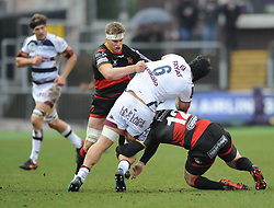 Bordeaux Marco Tauleigne tackled by Dragons Aaron Wainwright and Jack Dixon<br /> <br /> Photographer Mike Jones/Replay Images<br /> <br /> European Rugby Challenge Cup Round 6 - Dragons v Bordeaux Begles - Saturday 20th January 2018 - Rodney Parade - Newport<br /> <br /> World Copyright © Replay Images . All rights reserved. info@replayimages.co.uk - http://replayimages.co.uk
