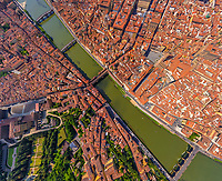 Aerial view above Arno river crossing the city of Florence, Italy